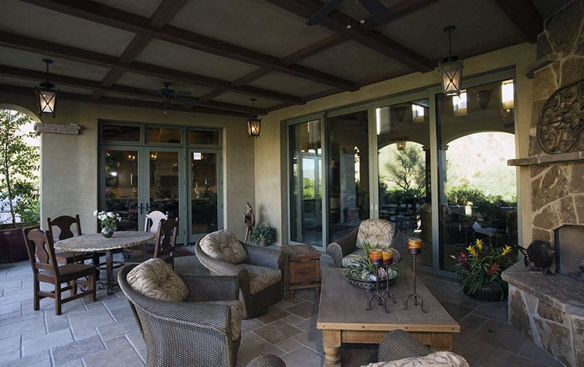 Beautiful covered patio with stone fireplace and furniture