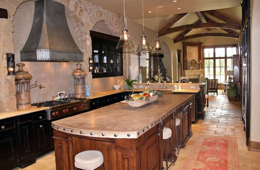 Beautiful Tuscan kitchen with arched ceilings brick walls and travertine floors