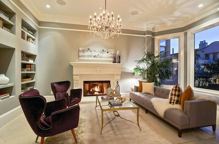 Beautifully decorated living room with fireplace and chandelier