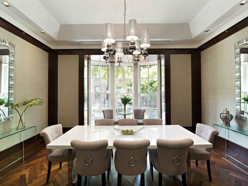 Beige and mahogany color dining room with wood parquet floors