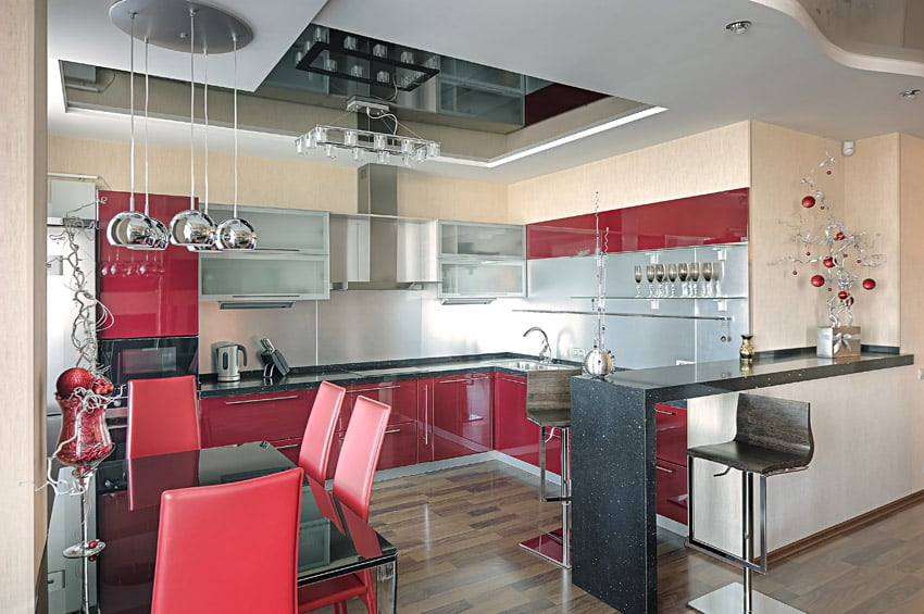 Black and red modern kitchen with dining peninsula
