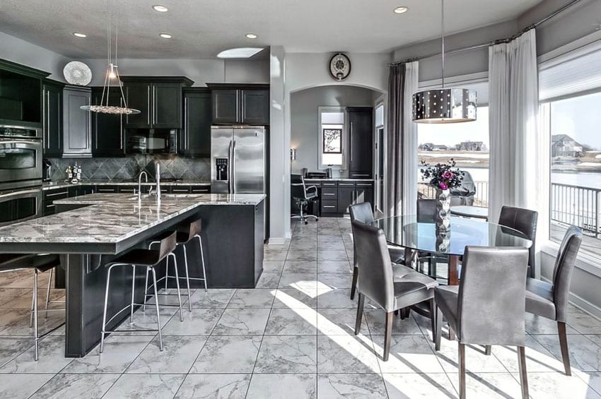 Black cabinet kitchen with open concept to dining area