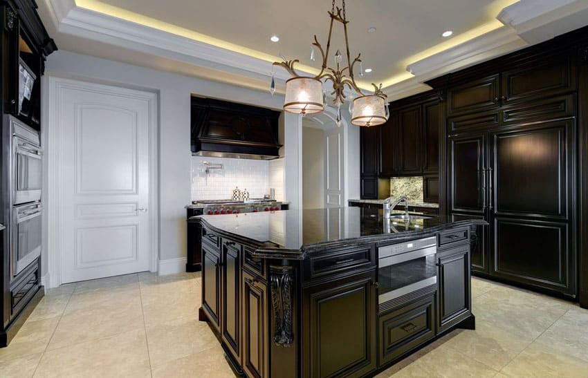 Black kitchen cabinets with island and white subway tile
