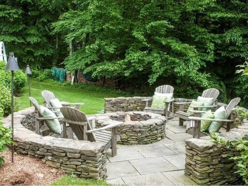Bluestone patio with rustic stacked stone fire pit