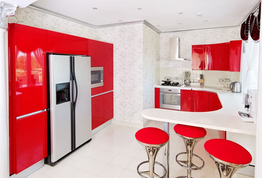 bright-red-modern-kitchen-with-white-counters-and-red-bar-stools