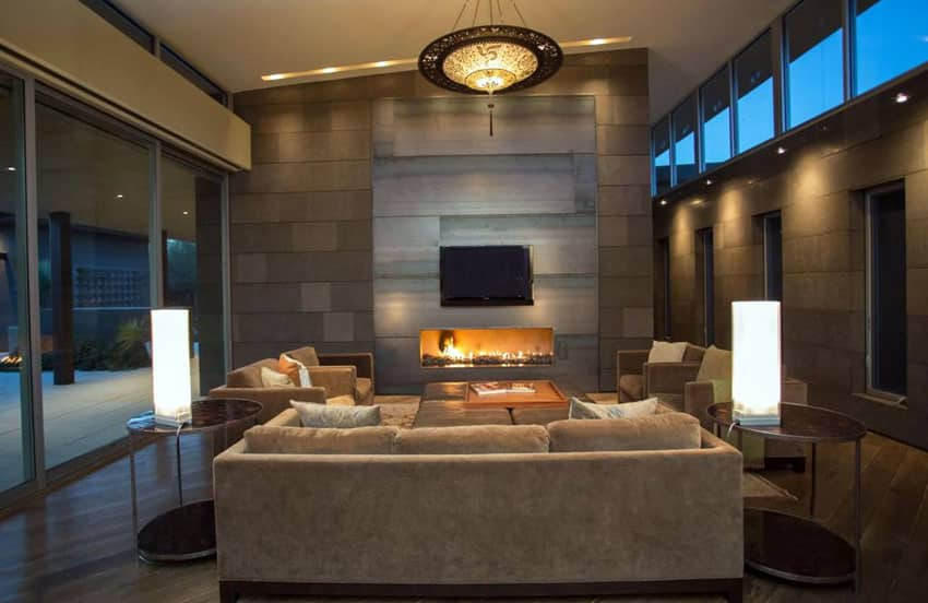 Brown contemporary living room with slanted roof and fireplace