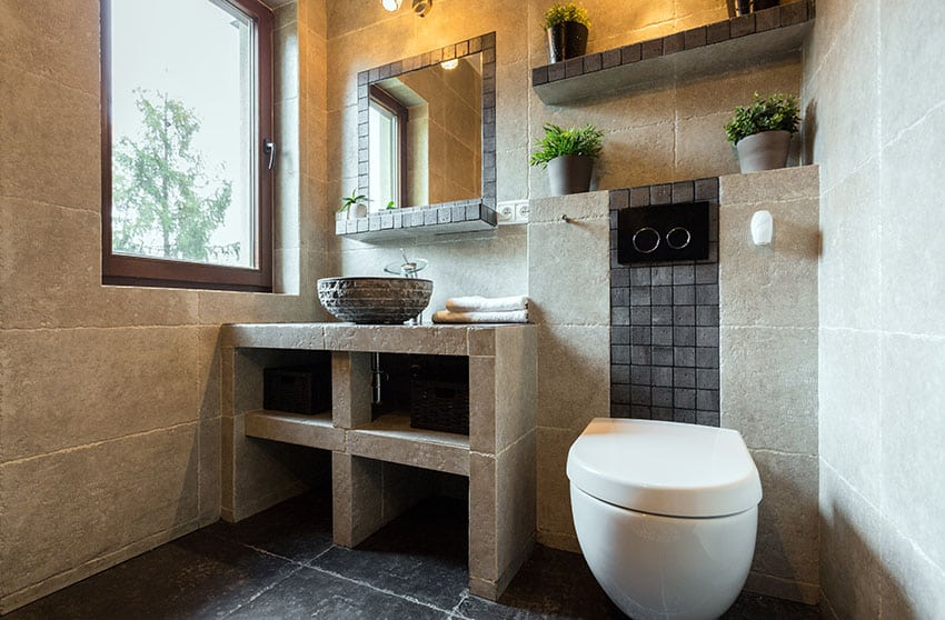 Compact bathroom with built in concrete sink vanity and shelving