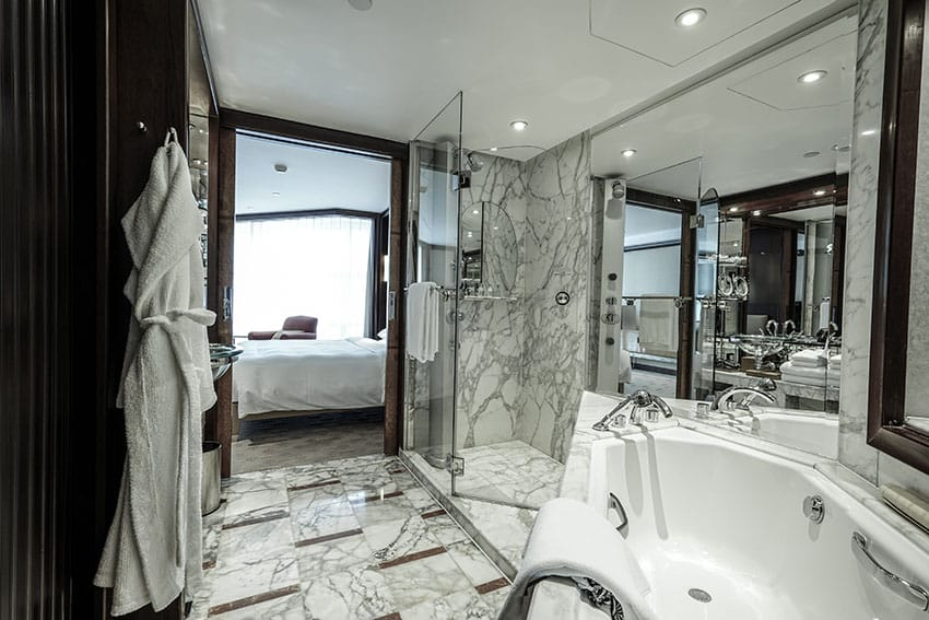 Compact bathroom with marble floors and shower