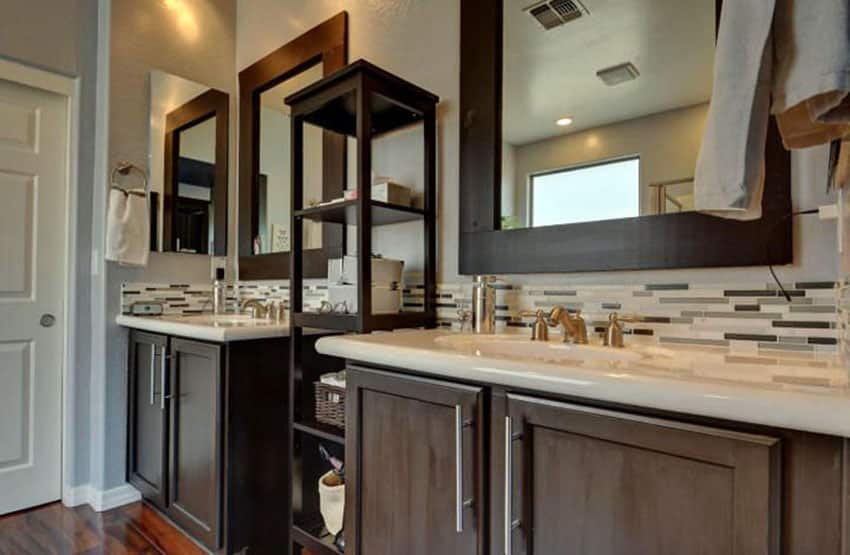 Contemporary bathroom with center shelving unit between sinks
