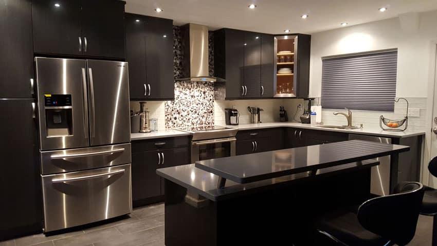 Contemporary black cabinet kitchen with breakfast bar island