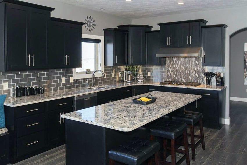 Contemporary kitchen with black cabinets, island and giallo verona granite counters