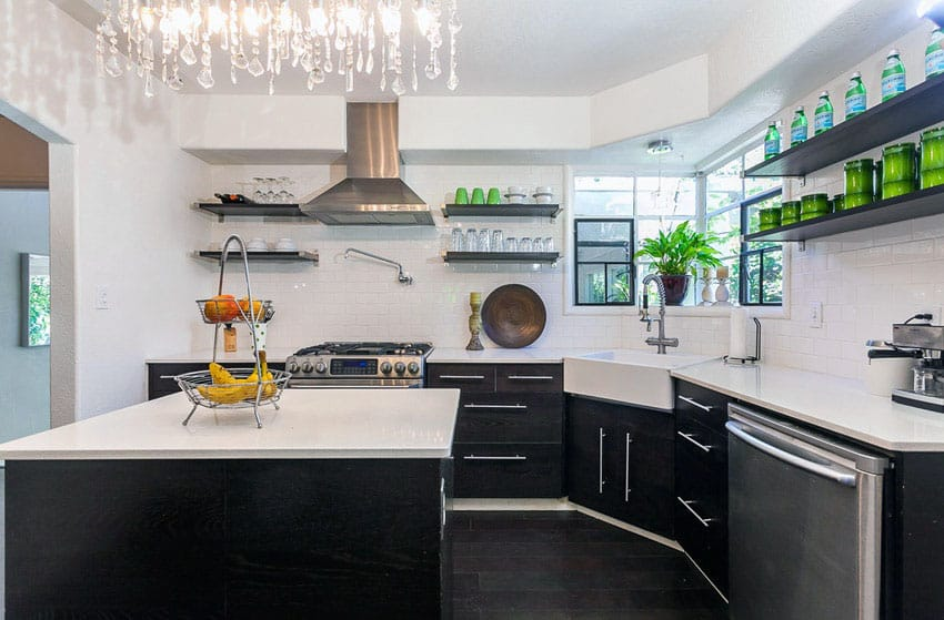 Contemporary kitchen with black cabinets and crystal chandelier