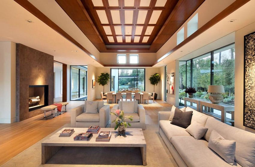 Contemporary living room design with intricate wood lace tray ceiling and fireplace