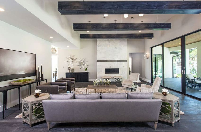 Contemporary living room with exposed beams, fireplace and large sliding glass door