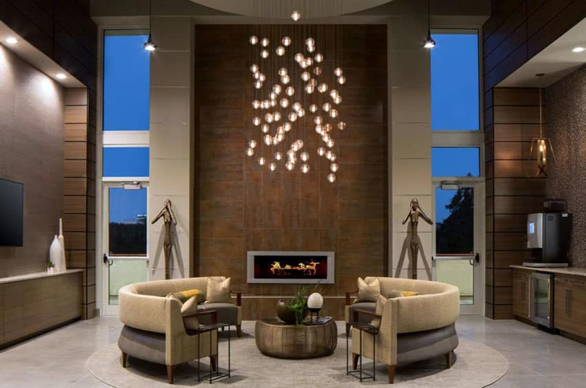 Contemporary living room with globe pendant lights