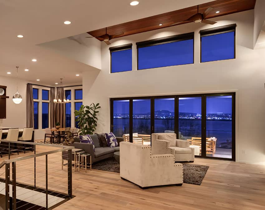 Contemporary living room with high ceiling and wood flooring