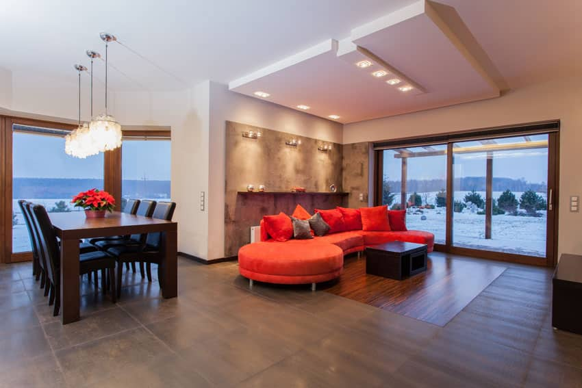 Contemporary living room with large red sectional couch