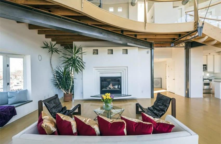 Contemporary loft style living room with fireplace and high ceiling