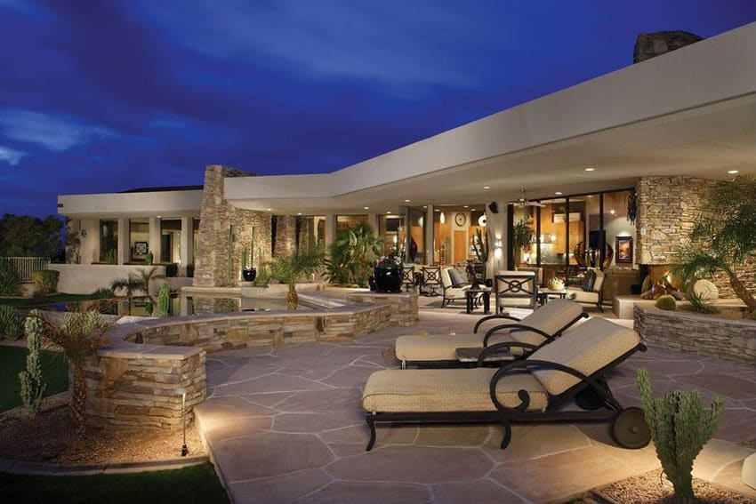 Contemporary patio with flagstone patio in the backyard on a luxury home