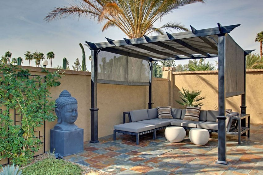 Contemporary stone slate patio with pergola and outdoor couch