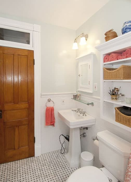 Cozy bathroom with white wall cabinet glass shelf and pedestal sink