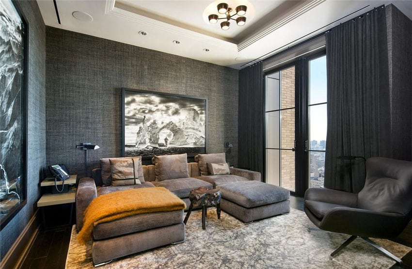Dark decorated contemporary living room with black patterned walls and drapery