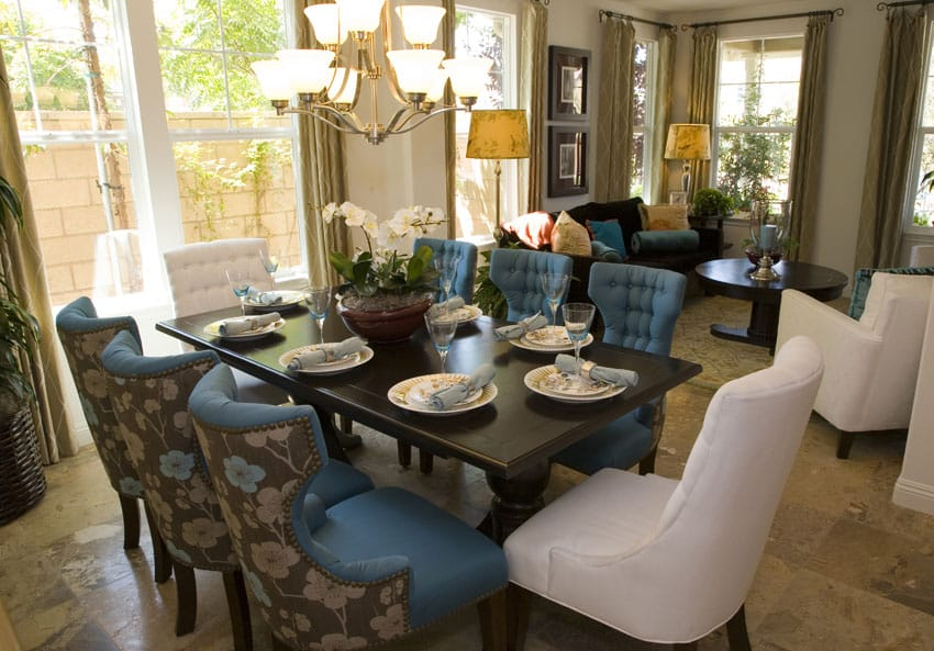 Dining room with blue chairs and white chairs