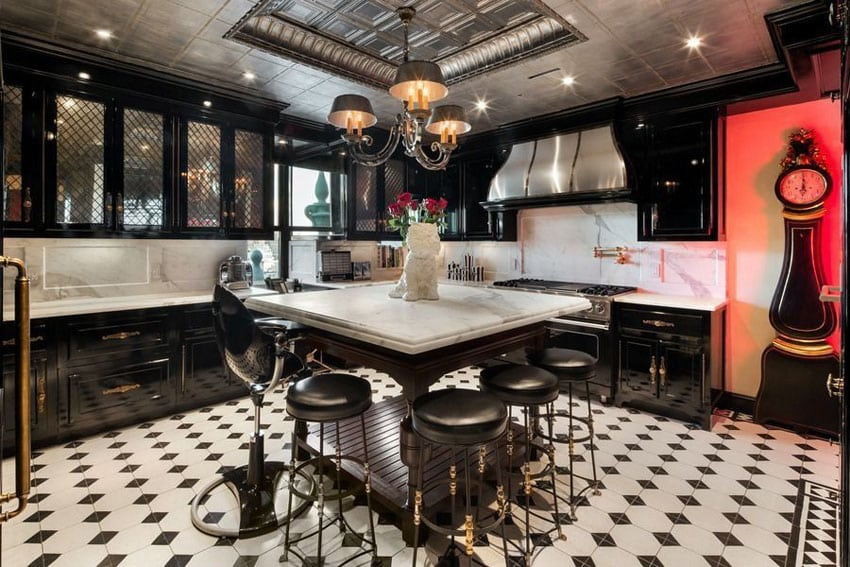 Eclectic kitchen with black cabinets with glass doors and white marble countertops