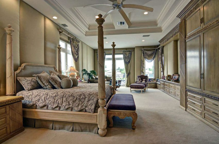 Elegant tan bedroom with wood built in storage and four poster bed