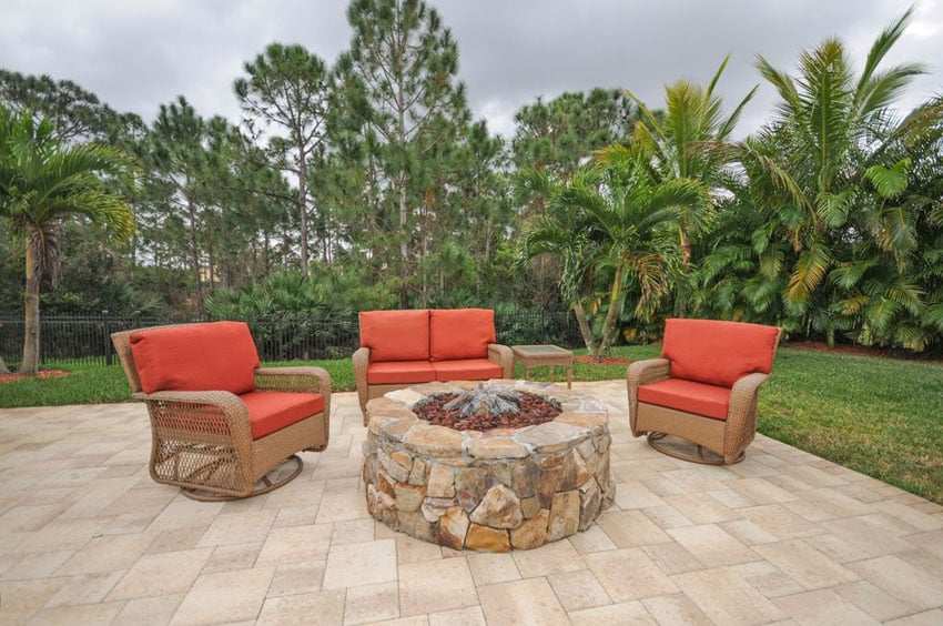 Flagstone patio with round rubble stone fire pit