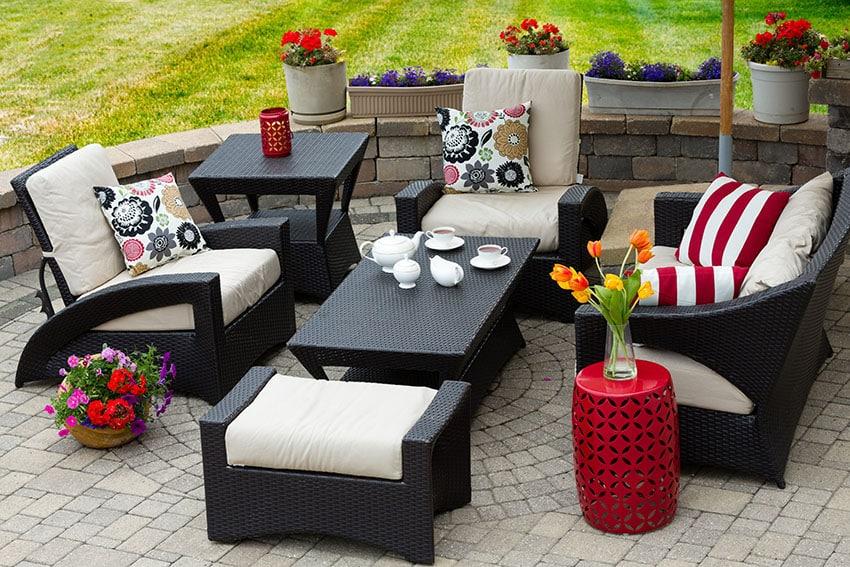 Furnished backyard paver patio with decorative circle design