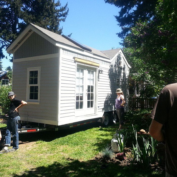 Gray and white tiny house on wheels
