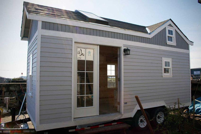 Gray painted tiny house on wheels
