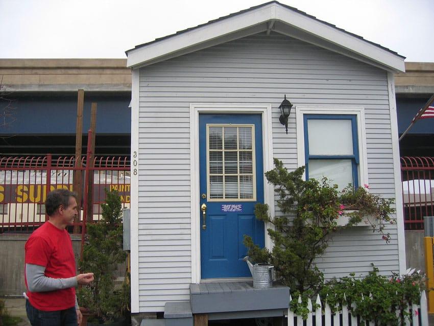 Gray tiny house with blue door