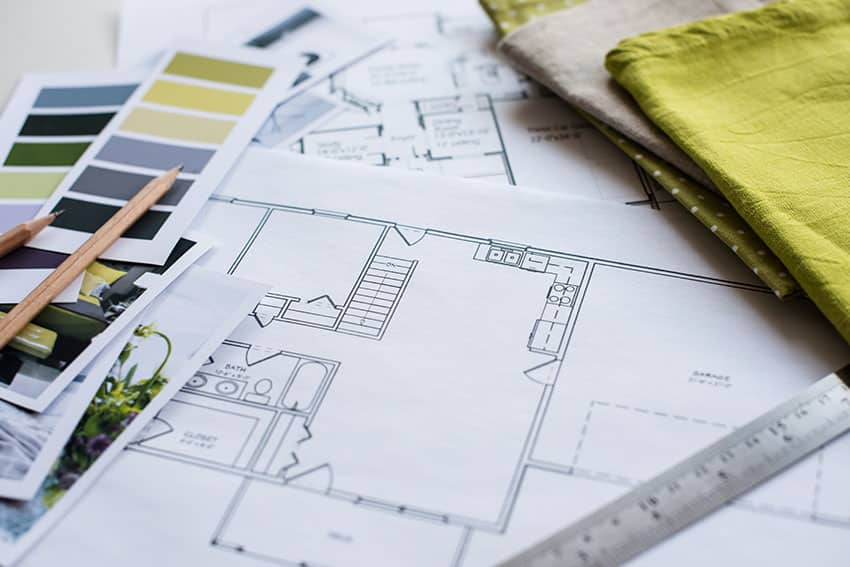 Interior design planning with color chart and blueprint