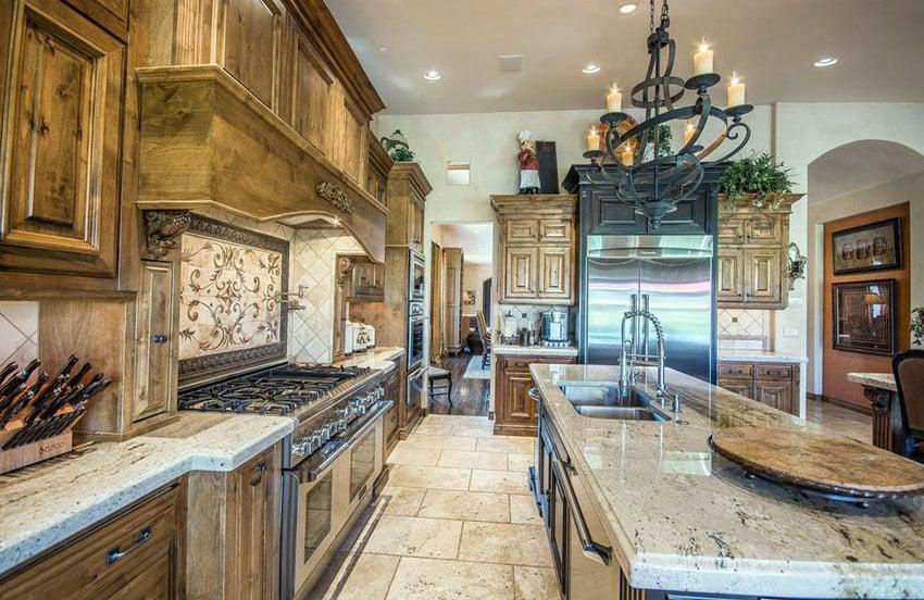 Italian style kitchen with decorative backsplash insert above oven