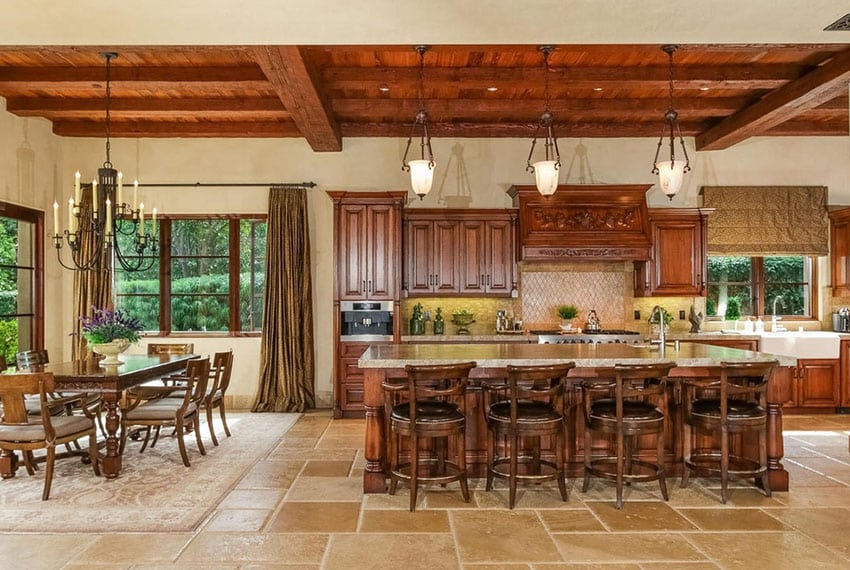 Italian style open concept kitchen with rustic wood beams