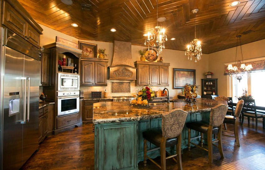Italian kitchen with wood cabinets and green distressed wood island