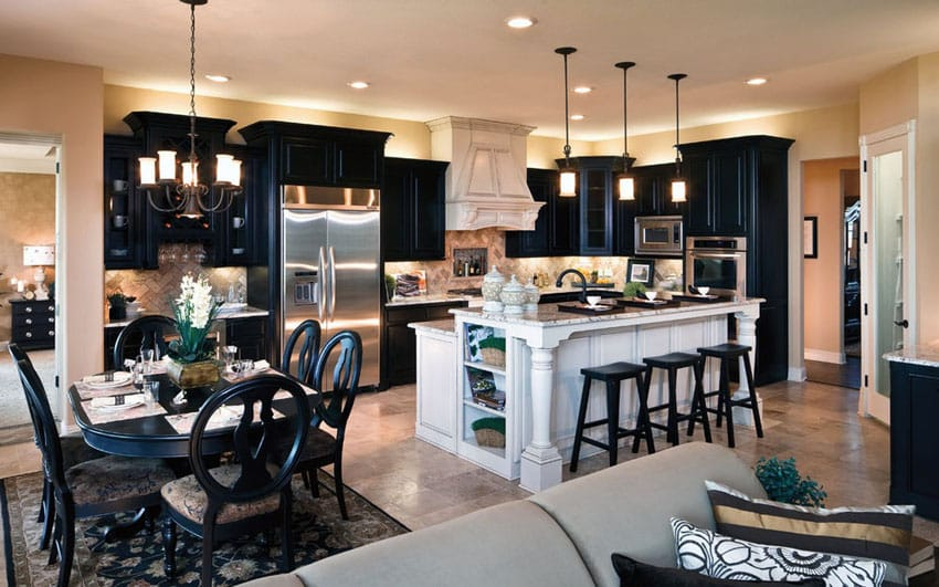 Kitchen with black cabinets and white island with open layout