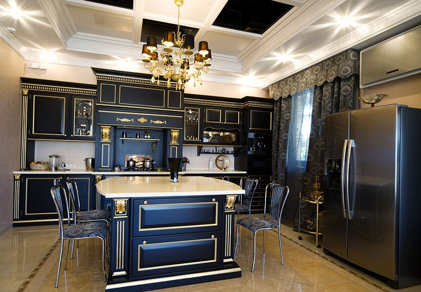 Kitchen with black cabinets with gold trim inlay and tray ceiling