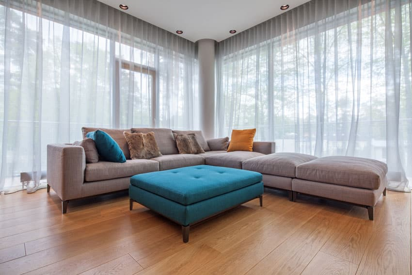 Large contemporary brown sectional couch with aqua blue ottoman