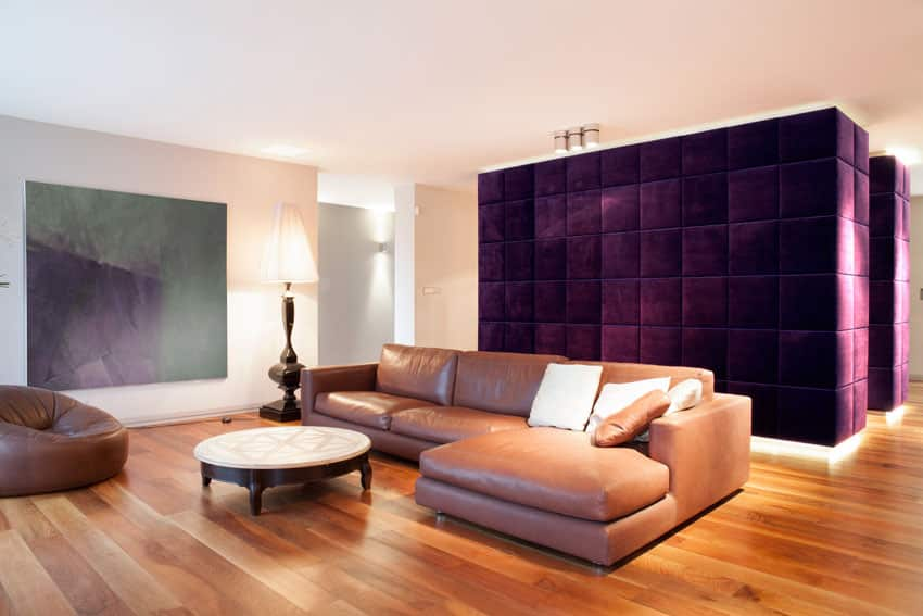 Living room with plush purple accent wall