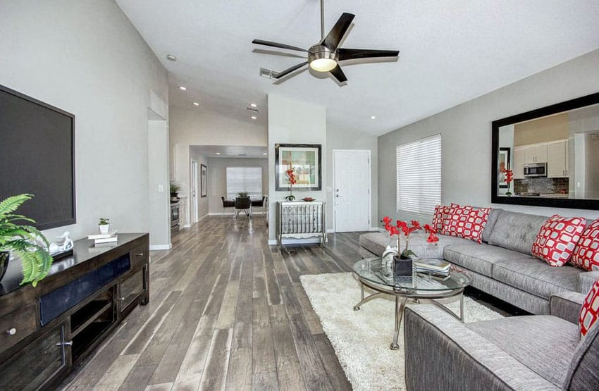 Living room with silver walls and hickory wood flooring