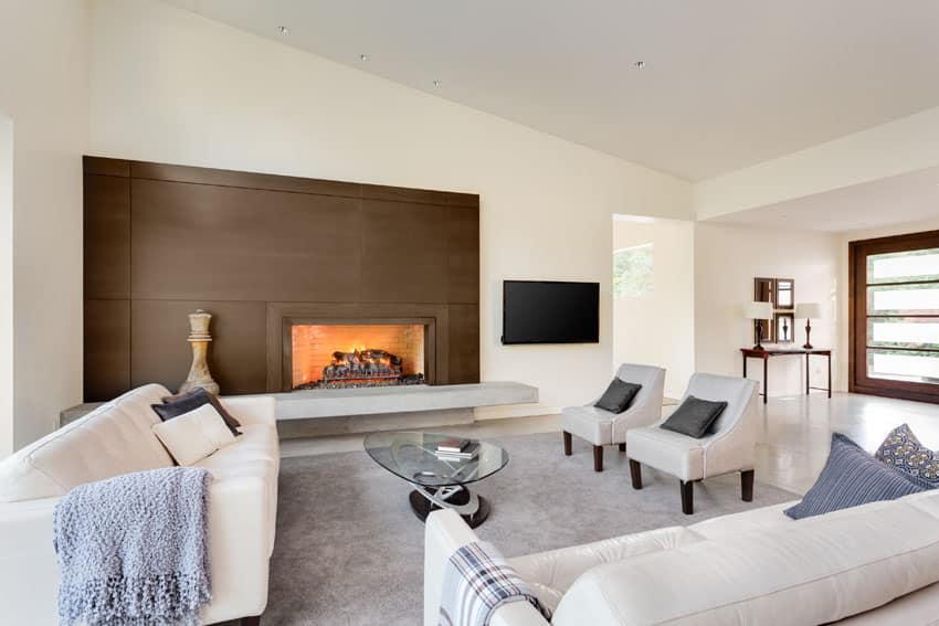 Living room with white furniture and fireplace