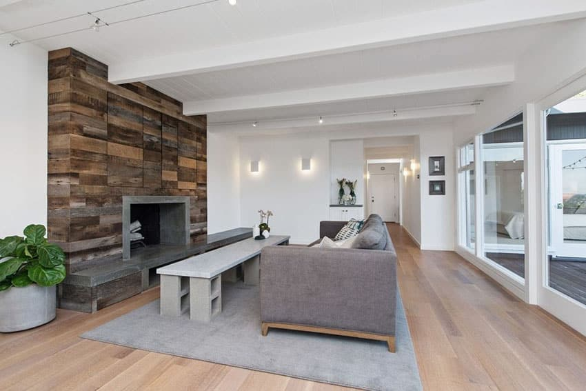 Living room with wood block fireplace surround and light wood flooring