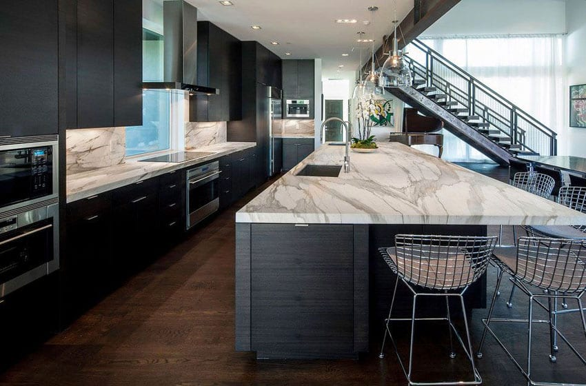 Luxury contemporary kitchen with black cabinets marble counter island