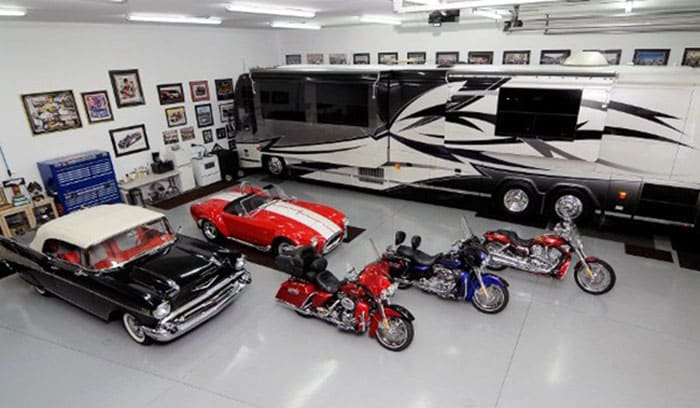 Luxury garage with RV, classic cars and motocycles