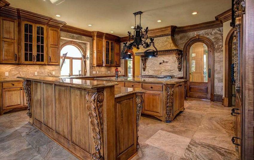 Mediterranean kitchen with beige marble countertops and backsplash with breakfast bar island