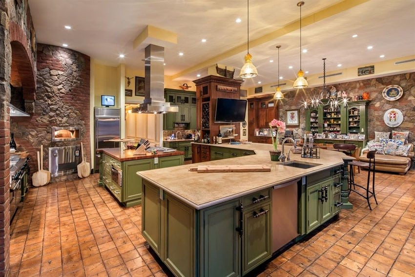 Mediterranean kitchen with limestone countertops and rustic brick pizza oven