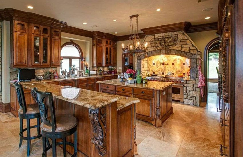Mediterranean kitchen with stone oven surround and decorative wood cabinets